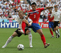 JUNE 9, 2006: Munich, Germany: German midfielder (7) Bastian Schweinsteiger tries to hold off Costa Rican defender Gilberto Martinez (5) during the World Cup Finals in Munich, Germany.  Germany defeated Costa Rica, 4-2.