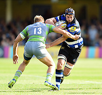 Paul Grant of Bath Rugby fends Chris Harris of Newcastle Falcons. Aviva Premiership match, between Bath Rugby and Newcastle Falcons on September 23, 2017 at the Recreation Ground in Bath, England. Photo by: Patrick Khachfe / Onside Images