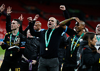 1st March 2020; Wembley Stadium, London, England; Carabao Cup Final, League Cup, Aston Villa versus Manchester City; Manchester City Manager Pep Guardiola celebrates towards the Manchester City fans with a winners medal alongside Phil Foden of Manchester City and Fernandinho of Manchester City