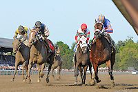 Turbulent Descent (no. 6), ridden by John Velazquez and trained by Todd Pletcher, wins the 34th running of the grade 1 Ballerina Stakes for fillies and mares three years old and upward on August 24, 2012 at Saratoga Race Track in Saratoga Springs, New York.  (Bob Mayberger/Eclipse Sportswire)