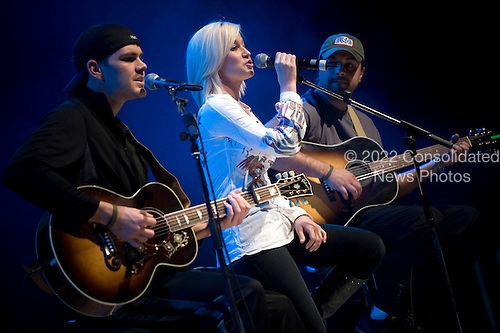 Ramstein AFB, Germany - December 16, 2008 -- American Idol contestant and country musician Kellie Pickler, center, and band mates Joshua Henson, left, and Ryan Ochsner, right, perform for service members during the 2008 USO Holiday Tour stop at Ramstein Air Force Base, Germany on Tuesday, December 16, 2008. Tour host United States Navy Admiral Mike Mullen, chairman of the Joint Chiefs of Staff and his wife Deborah were also joined by comedians Lewis Black, Kathleen Madigan and John Bowman; Actress Tichina Arnold and Grammy award winning musician Kid Rock on the tour bringing joy to service members and their families stationed overseas..Credit: Chad J. McNeeley - DoD via CNP