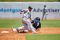Biloxi Shuckers second baseman Blake Allemand (7) puts a tag on Dalton Kelly (9) as he slides into second base on a stolen base attempt during a game against the Montgomery Biscuits on May 8, 2018 at Montgomery Riverwalk Stadium in Montgomery, Alabama.  Montgomery defeated Biloxi 10-5.  (Mike Janes/Four Seam Images)