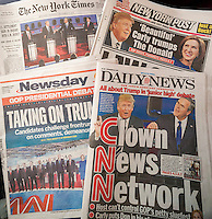 Headlines of New York newspapers on Thursday, September 17, 2015 report on the Republican presidential debate, notably the performance of Donald Trump.  (© Richard B. Levine)