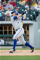 Richie Shaffer (28) of the Durham Bulls follows through on his swing against the Charlotte Knights at BB&T BallPark on July 22, 2015 in Charlotte, North Carolina.  The Knights defeated the Bulls 6-4.  (Brian Westerholt/Four Seam Images)