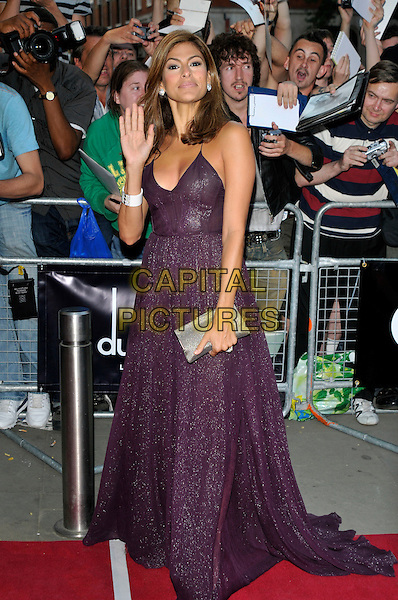 EVA MENDES.The GQ Men Of The Year Awards 2009 held at the Royal Opera House, Covent Garden, London, England..8th September 2009.full length purple aubergine long maxi dress mendez sparkly silver clutch bag fans crowd hand palm waving .CAP/PL.©Phil Loftus/Capital Pictures.