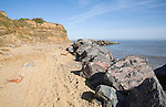 Rock armour used to defend soft crumbling cliffs, Happisburgh, Norfolk, England