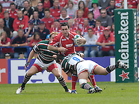 Leicester, Great Britain, Scarlets' Stephen JONES, tackled by Harry ELLIS, during the Heineken Cup Semi Final, Leicester Tigers vs Llanelli Scarlets played at the Walker Stadium, on Sat. 21.04.2007.