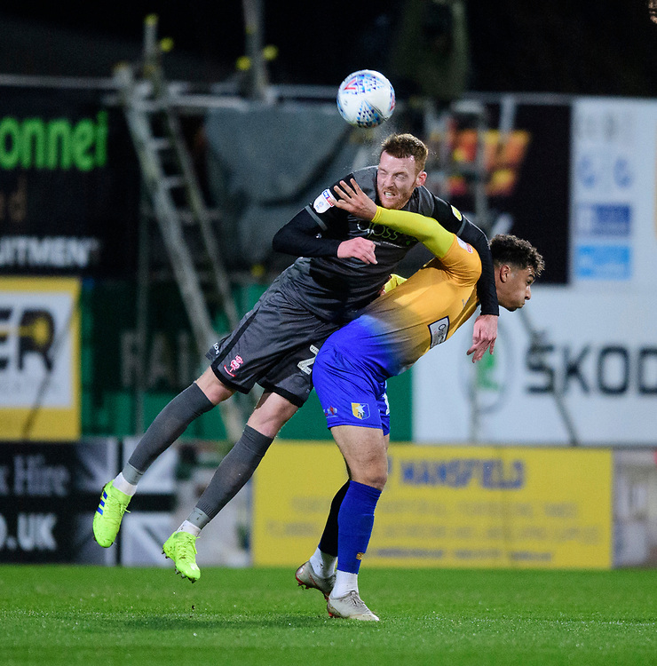 Lincoln City's Cian Bolger vies for possession with Mansfield Town's Tyler Walker<br /> <br /> Photographer Chris Vaughan/CameraSport<br /> <br /> The EFL Sky Bet League Two - Mansfield Town v Lincoln City - Monday 18th March 2019 - Field Mill - Mansfield<br /> <br /> World Copyright © 2019 CameraSport. All rights reserved. 43 Linden Ave. Countesthorpe. Leicester. England. LE8 5PG - Tel: +44 (0) 116 277 4147 - admin@camerasport.com - www.camerasport.com