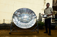 CHAD, N`Djamena , cooking with solar cooker / TSCHAD, Ndjamena, kochen mit Solarkocher