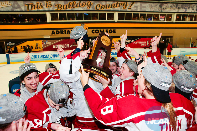 ADRIAN, MI - MARCH 18: The Plattsburgh State team celebrate with the National Championship trophy after winning the Division III Women's Ice Hockey Championship held at Arrington Ice Arena on March 19, 2017 in Adrian, Michigan. Plattsburgh State defeated Adrian 4-3 in overtime to repeat as national champions for the fourth consecutive year. by Tony Ding/NCAA Photos via Getty Images)