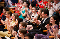 Contestants applaud during the opening ceremony of the 11th USA International Harp Competition at Indiana University in Bloomington, Indiana on Wednesday, July 3, 2019. (Photo by James Brosher)