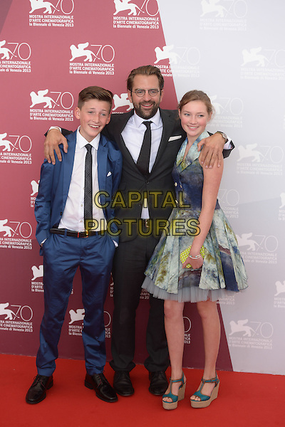 Levin Liam, Rick Ostermann, Helena Phil<br /> 'Wolfskinder' Photocall during the 70th Venice International Film Festival, Venice, Italy.<br /> August 29th, 2013<br /> full length white suit tie shirt black glasses beard facial hair hands arms over shoulders blue dress yellow wedges shoes dress tie dye<br /> CAP/ZZG<br /> &copy;ZZG/Capital Pictures
