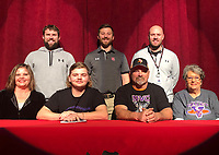 RICK PECK/SPECIAL TO MCDONALD COUNTY PRESS Izak Johnson, third baseman for the McDonald County High School baseball team, recently signed a letter of intent to continue his baseball career at Missouri Valley College in Marshall, Mo. Front row, left to right: Shauna Lopez (mom), Izak Johnson, David Lopez (dad) and Linda Dial (grandmother).Back row: MCHS baseball coaches Kellen Hoover, Kevin Burgi and Bo Bergen.
