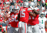 Ohio State Buckeyes running back Ezekiel Elliott (15) celebrates his touchdown with Ohio State Buckeyes offensive lineman Chase Farris (57) in the 1st quarter of their game against Hawaii Warriors at Ohio Stadium on September 12, 2015.  (Dispatch photo by Kyle Robertson)