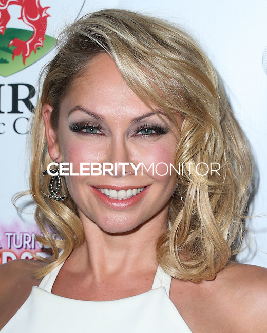 BEVERLY HILLS, CA, USA - SEPTEMBER 13: Kym Johnson arrives at the Brent Shapiro Foundation For Alcohol And Drug Awareness' Annual 'Summer Spectacular Under The Stars' 2014 held at a Private Residence on September 13, 2014 in Beverly Hills, California, United States. (Photo by Xavier Collin/Celebrity Monitor)