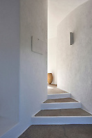 The entrance to the contemporary villa is via a set of shallow stone steps