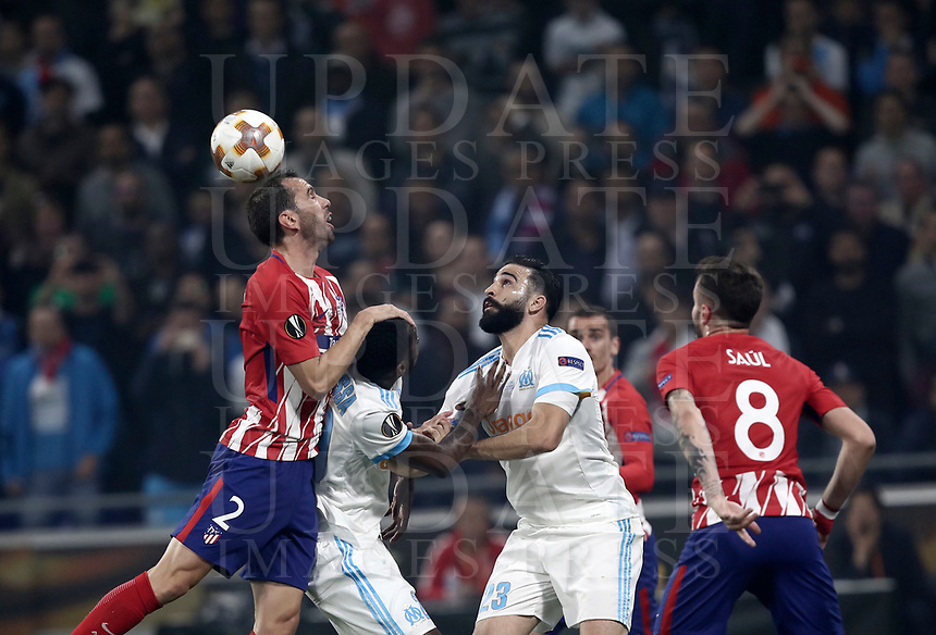 Club Atletico de Madrid's Diego Godin, left, is challenged by Olympique de Marseille's Andre Zambo Anguissa, second from left, and Adil Rami, during the UEFA Europa League final football match between Olympique de Marseille and Club Atletico de Madrid at the Groupama Stadium in Decines-Charpieu, near Lyon, France, May 16, 2018.<br /> UPDATE IMAGES PRESS/Isabella Bonotto