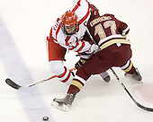 Joe Pereira (BU - 6), Brian Gibbons (BC - 17) - The visiting Boston College Eagles defeated the Boston University Terriers 3-2 to sweep their Hockey East series on Friday, January 21, 2011, at Agganis Arena in Boston, Massachusetts.