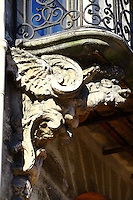 A particular of the decoration of a balcony (XVIII century) of rue Saint Antoine in the Marais, Paris. Digitally Improved Photo.