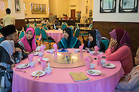 "January 15, 2015 - Rawang (Malaysia). Global Ikhwan's CEO Lokman Hakim, has lunch with his 4 wives and 3 of his 27 children in a Chinese restaurant in Rawang. Although polygamy is legal in Malaysia, it is rarely practiced in the open or with the knowledge and approval of all the wives involved in such a relationship. However, Global Ikhwan - only employs women, who view polygamy as the integral element of ""the Islamic way of life."" © Thomas Cristofoletti / Ruom"