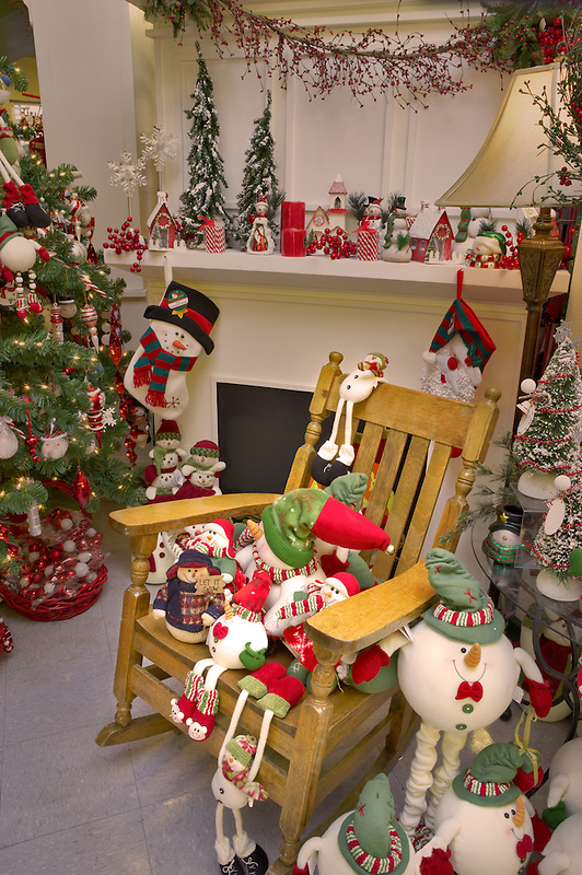 Christmas decorations on fireplace mantle with rocking chair. Al's Nursery. Woodburn. Oregon