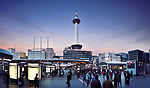 View on Kyoto tower from Kyoto Station busy with people in the evening, beautiful sunset city scenery in Shimogyo-ku, Kyoto, Japan 2017.