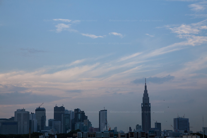 Tokyo Skyline with the NTT Docomo Tower to the right. Shinjuku, Tokyo, Japan Friday August 1st 2014