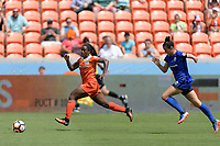 Houston, TX - Saturday May 27, 2017: Nichelle Prince (14) of the Houston Dash races towards the goal with Carson Pickett in pursuit during a regular season National Women's Soccer League (NWSL) match between the Houston Dash and the Seattle Reign FC at BBVA Compass Stadium.