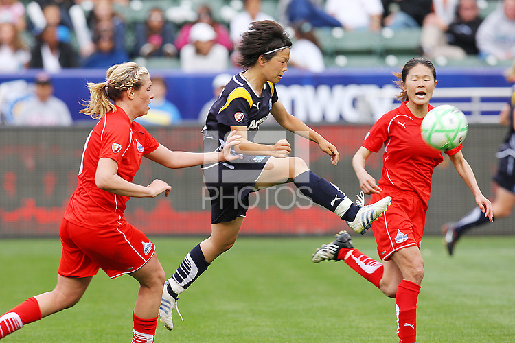 Aya Miyama #8 of the Los Angeles Sol attacks the defense of the Washington Freedom during their inaugural match at Home Depot Center on March 29, 2009 in Carson, California.