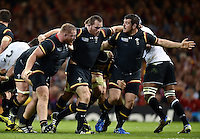 The Wales front row of Samson Lee, Ken Owens and Aaron Jarvis in action. Rugby World Cup Pool A match between Wales and Fiji on October 1, 2015 at the Millennium Stadium in Cardiff, Wales. Photo by: Patrick Khachfe / Onside Images