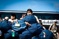 A scout from Japan is happy about the unloaded bus