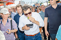 South Bend mayor and Democratic presidential candidate Pete Buttigieg eats a Bacon Ball BLT at the Iowa State Fair in Des Moines, Iowa, on Tues., Aug. 13, 2019.