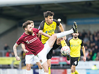 5th January 2020; Pirelli Stadium, Burton Upon Trent, Staffordshire, England; English FA Cup Football, Burton Albion versus Northampton Town; Paul Anderson of Northampton Town gets his leg high as Scott Fraser of Burton Albion clears the ball - Strictly Editorial Use Only. No use with unauthorized audio, video, data, fixture lists, club/league logos or 'live' services. Online in-match use limited to 120 images, no video emulation. No use in betting, games or single club/league/player publications