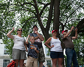 A group gestures for tractor trailers to blow their horn as they make their way through the 4th of July parade on Constitution Avenue in Washington D.C. on July 4, 2019.<br /> <br /> Credit: Stefani Reynolds / CNP