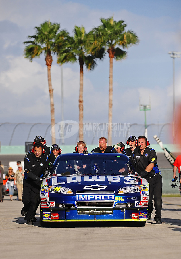 Nov. 20, 2010; Homestead, FL, USA; Crew members push the car of NASCAR Sprint Cup Series driver Jimmie Johnson during practice for the Ford 400 at Homestead Miami Speedway. Mandatory Credit: Mark J. Rebilas-