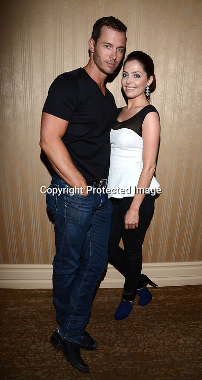 Jen Lilley and  Eric Martsolf attend the Daytime Emmy Gifting Suite presented by Off The Wall Promotions on June 21, 2014 at  the Beverly Hilton Hotel in Beverly Hills, California.