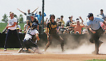 Hays Daily News &bull; Chad Pilster<br /> <br /> Central Oklahoma's catcher Tori Collet (11) tags out Fort Hays State University's Kellsi Olsen (4) as fans react to the close call on Sunday, May 12, 2013, during the NCAA Division II Softball Central 1 Regional championship at Tiger Stadium at Fort Hays State University in Hays, Kansas. FHSU lost to Central Oklahoma 7-1.
