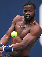 MIAMI GARDENS, FL - MARCH 17: Frances Tiafoe on the practice court prior to the start of the Miami Open Tennis Tournament at Hard Rock Stadium on March 17, 2019 in Miami Gardens, Florida.<br /> <br /> People: Frances Tiafoe