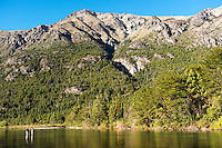 Anglers fish beneath Andean peaks on the Rio Carreleufu in central Patagonia.