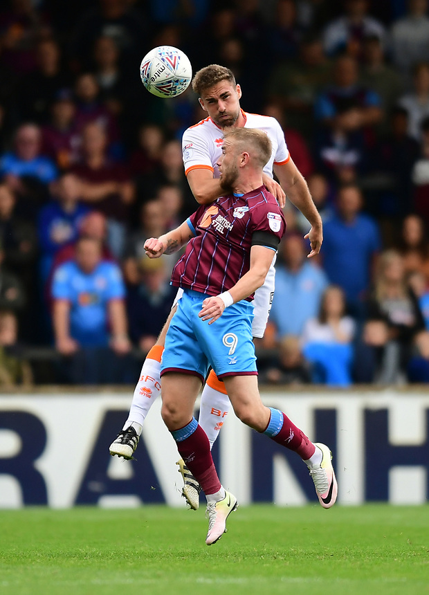 Scunthorpe United's Paddy Madden vies for possession with Blackpool's Clark Robertson<br /> <br /> Photographer Chris Vaughan/CameraSport<br /> <br /> The EFL Sky Bet League One - Scunthorpe United v Blackpool - Saturday 9th September 2017 - Glanford Park - Scunthorpe<br /> <br /> World Copyright &copy; 2017 CameraSport. All rights reserved. 43 Linden Ave. Countesthorpe. Leicester. England. LE8 5PG - Tel: +44 (0) 116 277 4147 - admin@camerasport.com - www.camerasport.com