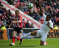 SUNDERLAND, ENGLAND - MAY 13: (L-R) Seb Larsson of Sunderland has his shot blocked by Jordan Ayew of Swansea City during the Premier League match between Sunderland and Swansea City at the Stadium of Light, Sunderland, England, UK. Saturday 13 May 2017