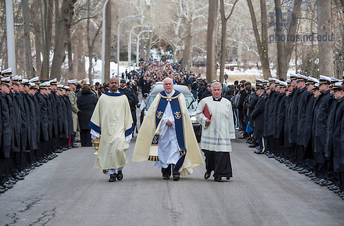 Mar. 4, 2015; Rev. Thomas O'Hara, C.S.C., Provincial Superior of the Congregation of Holy Cross, leads the procession to the cemetery following the funeral of President Emeritus Rev. Theodore M. Hesburgh, C.S.C. (Photo by Barbara Johnston/University of Notre Dame)