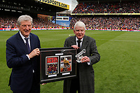 Crystal Palace manager, Roy Hodgson presents John Motson with a crystal microphone and a framed programme during the EPL - Premier League match between Crystal Palace and West Bromwich Albion at Selhurst Park, London, England on 13 May 2018. Photo by Carlton Myrie / PRiME Media Images.