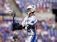 Ned Crotty (22) of Duke passes the ball off during the NCAA Men's Lacrosse Championship held at M&T Stadium in Baltimore, MD.  Duke defeated Notre Dame, 6-5, to win the title in overtime.