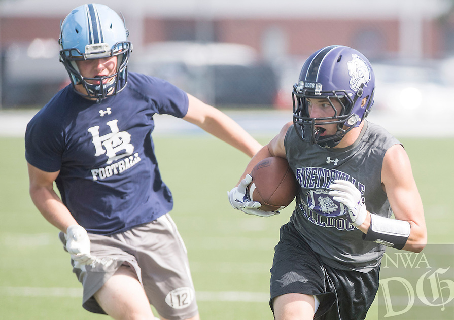 NWA Democrat-Gazette/J.T. WAMPLER -Fayetteville High School's Luke Rapert looks for running room during the championship game of Southwest Elite 7 on 7 Tournament at Shiloh Christian against Har-Ber High School Saturday July 11, 2015.