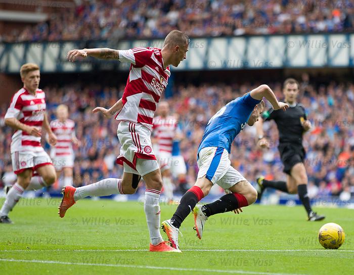 Antons Kurakins fouls Andy Halliday on the edge of the box