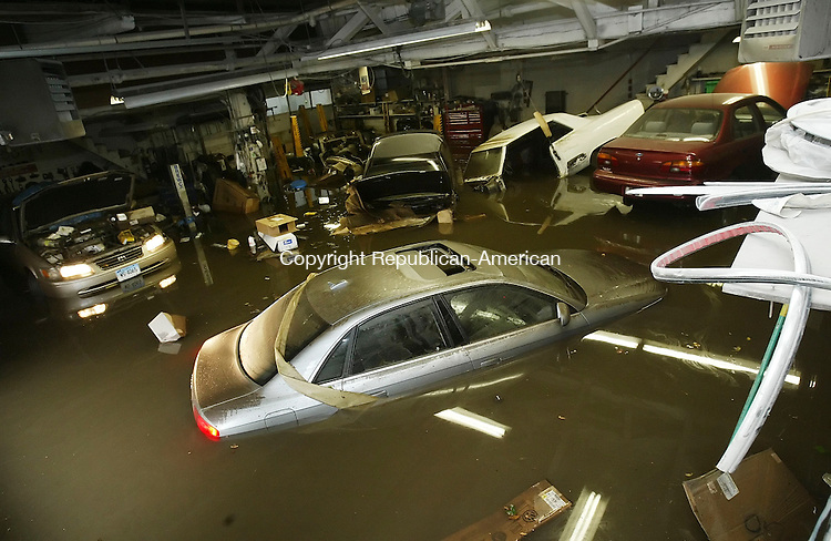 WATERBURY,  CT 17 September 2005 -091705BZ15- The lower garage at Jake's Auto Body and Painting Works, Inc. on Meadow Street was flooded after heavy rain soaked the area Saturday afternoon.  Speaking of the destruction to the garage David DiMichele (CQ), V.P. of Jake's, said &quot;What are you gonna do?  That's mother nature, nobody can control it...today she roared.&quot;<br /> DiMichele said at least 9 vehicles, several welders, 2 air compressors, frame straightening machines, and thousands of dollars of other equipment and tools were ruined.<br /> Jamison C. Bazinet / Republican-American