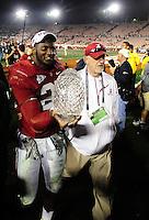 Jan 7, 2010; Pasadena, CA, USA; Alabama Crimson Tide linebacker Rolando McClain (25) holds the Coaches' Trophy after defeating the Texas Longhorns 37-21 in the 2010 BCS national championship game at the Rose Bowl. Mandatory Credit: Mark J. Rebilas-.
