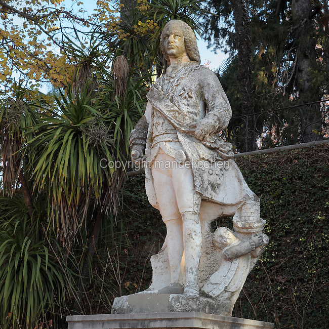 Statue of Ferdinand VI of Spain, 1717-59, on the terrace outside the main building of the Carmen de los Martires Garden, on the site of a Barefoot Carmelite shrine and convent originally established in 1492, in Granada, Andalusia, Southern Spain. A Carmen is a traditional house with enclosed garden, this example dates to the 19th century and displays various garden styles including English, Spanish and Nasrid. Picture by Manuel Cohen