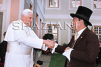 sindaco di Bressanone, Albert Purgstaller, Pope Benedict XVI during a ceremony where he received the honorary citizenship of Bressanone, in this Northern Italian mountain resort,.. Aug. 9, 2008...